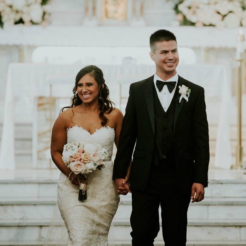 """The couple leaving the ceremony after saying """"I Do""""."""