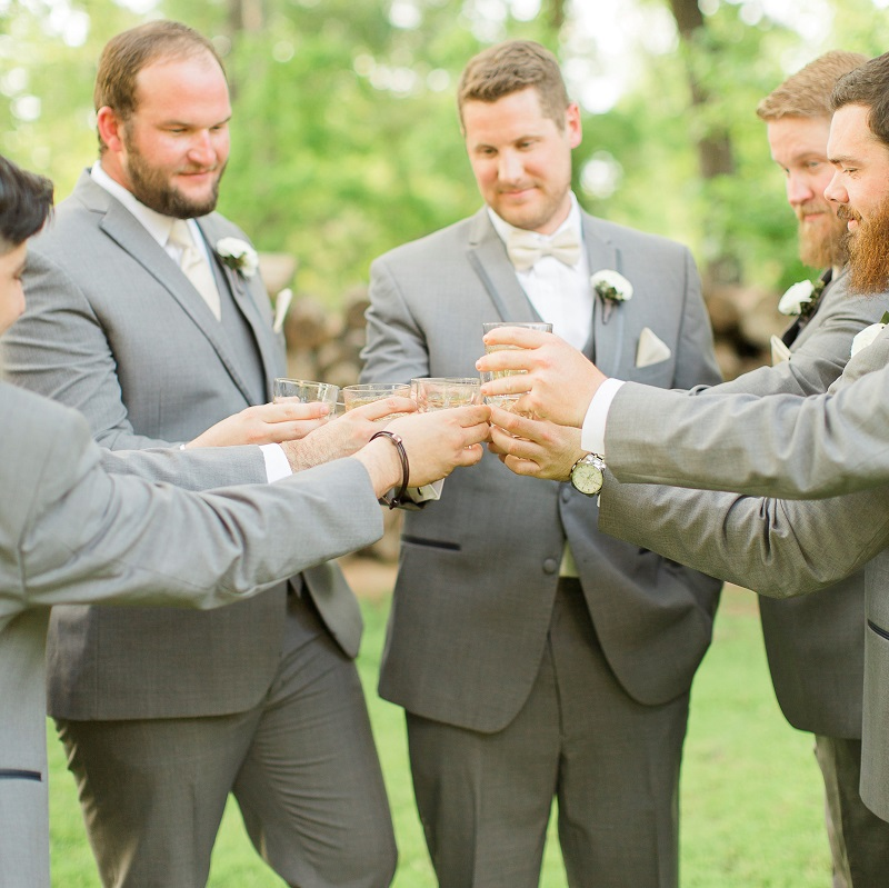 The groomsmen having a drink before the ceremony.