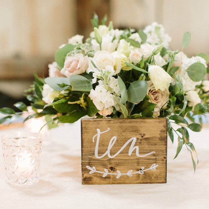 Wedding centerpiece and table number.