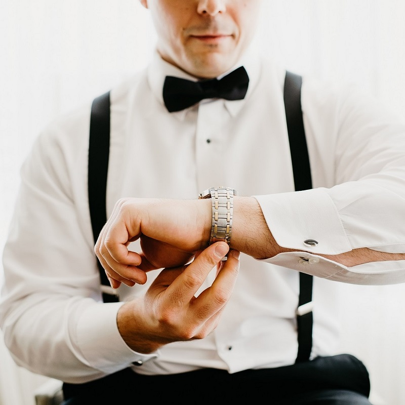 The groom getting dressed for his wedding day.