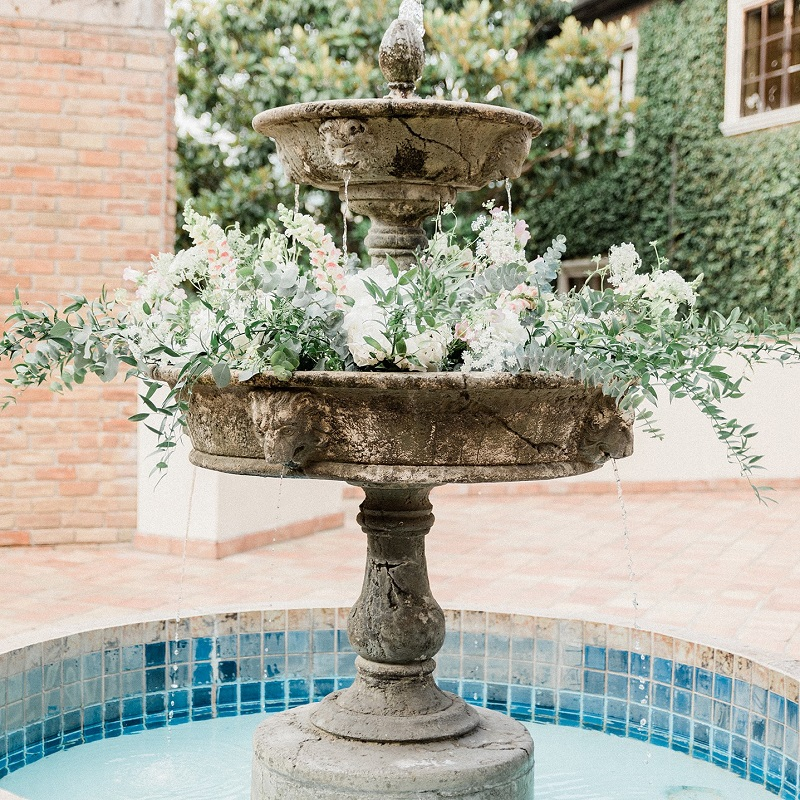 Floral detail added to the fountain for the ceremony.