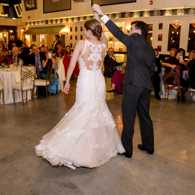 The bride and groom dancing.