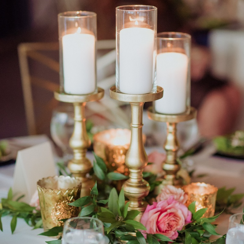 Bright floral and candle centerpiece.