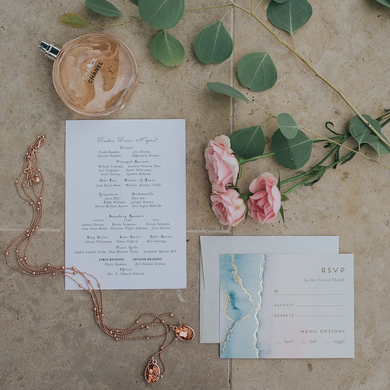 Wedding details and invitation suite.
