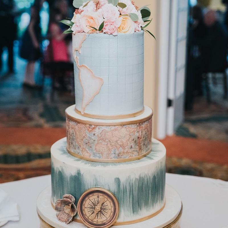 Travel themed wedding cake.