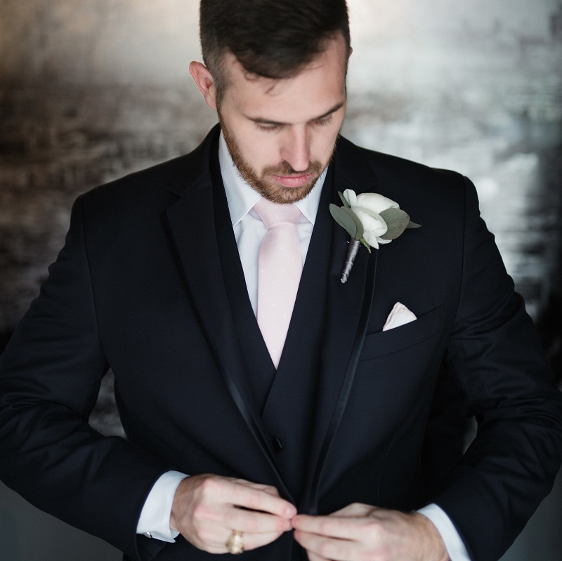The groom getting ready for his wedding day.