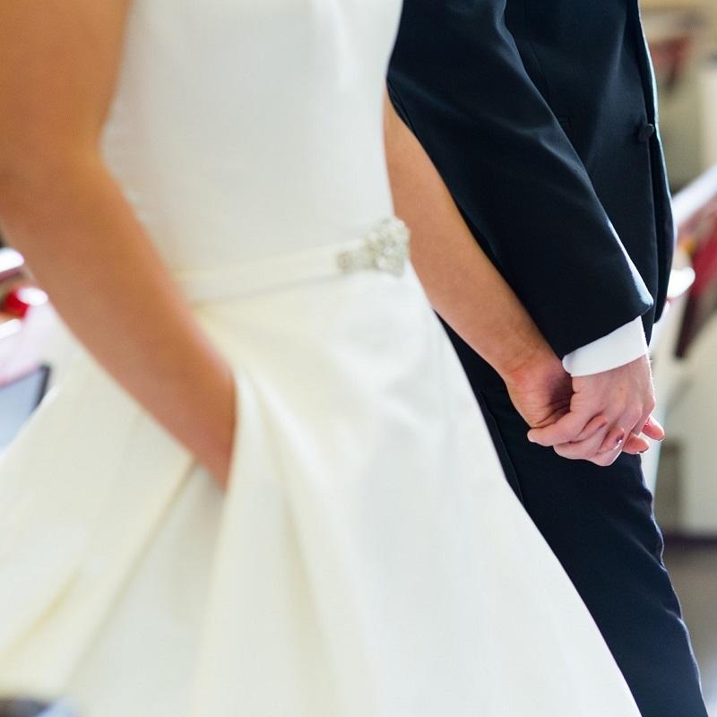 Her wedding dress has pockets.