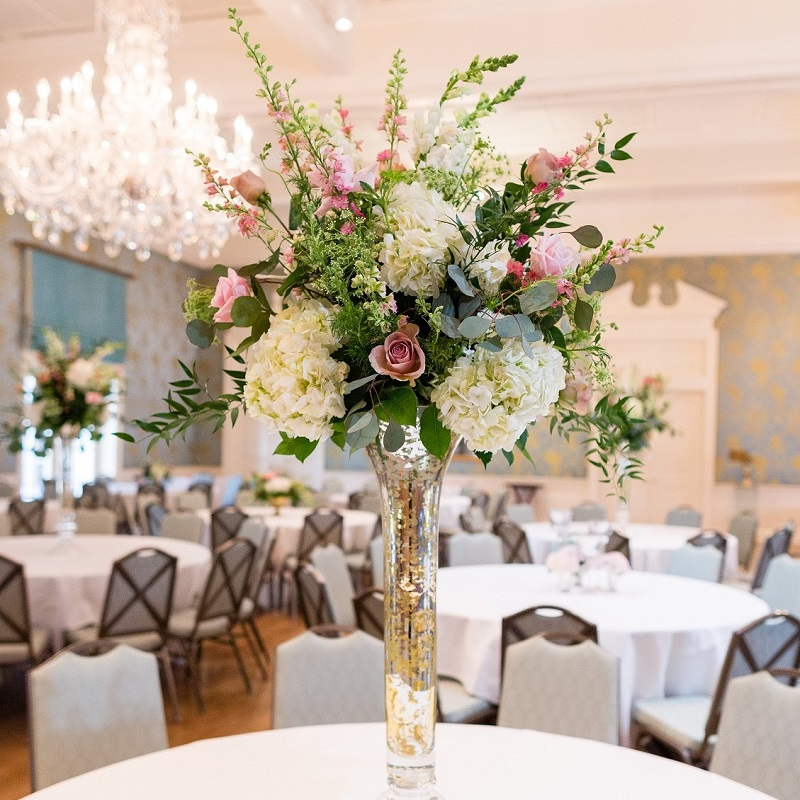 Ivory and blush tall ceremony arrangement.