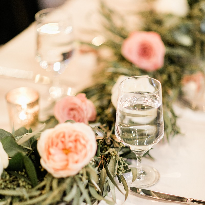 Floral and greenery garland wedding centerpiece.