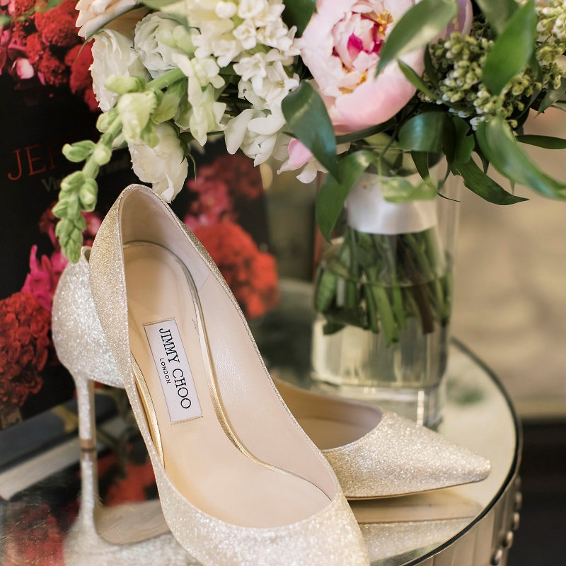 The wedding shoes and bouquet.