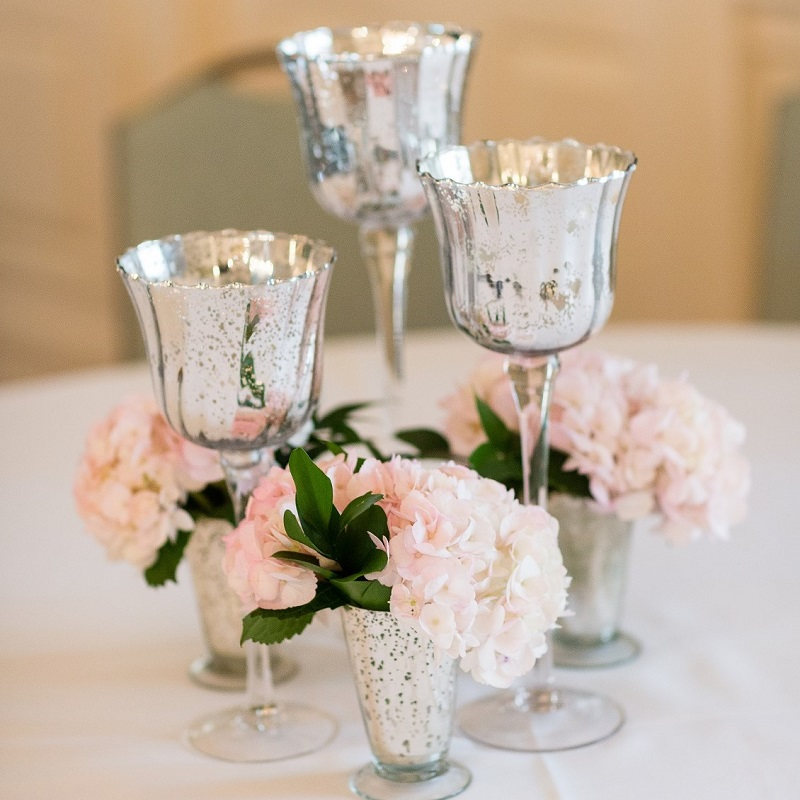 Trio of candles with julep floral vases for a second wedding centerpiece option.