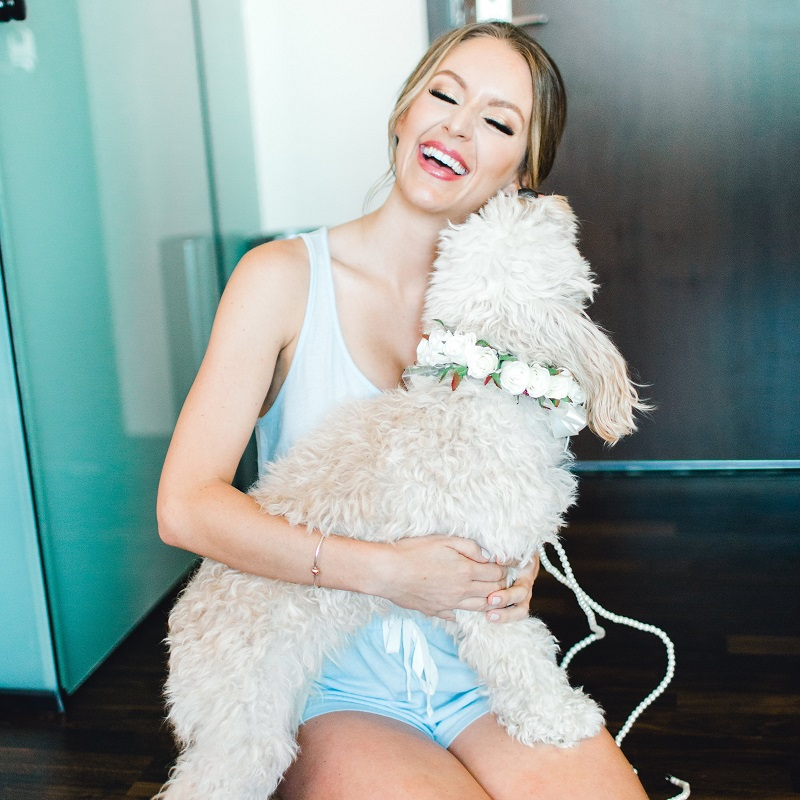 The bride and her dog on her wedding day.