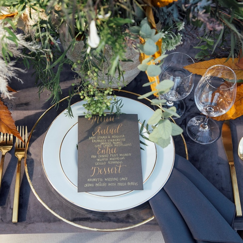 Wedding place setting with menu card displayed.