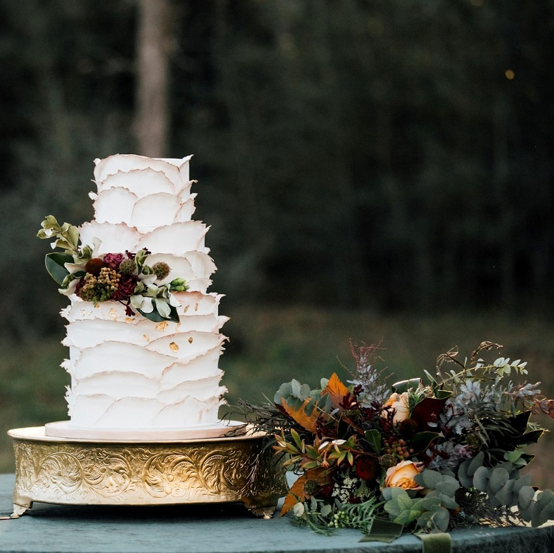 The wedding cake and bouquet.