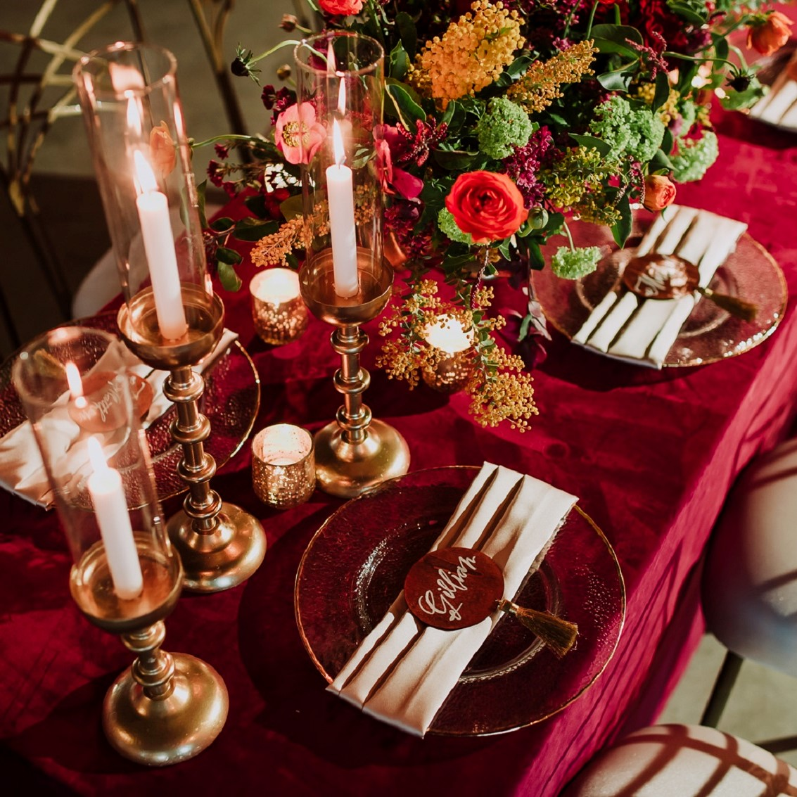 Velvet linen with romantic candles, floral cascade and glass chargers.