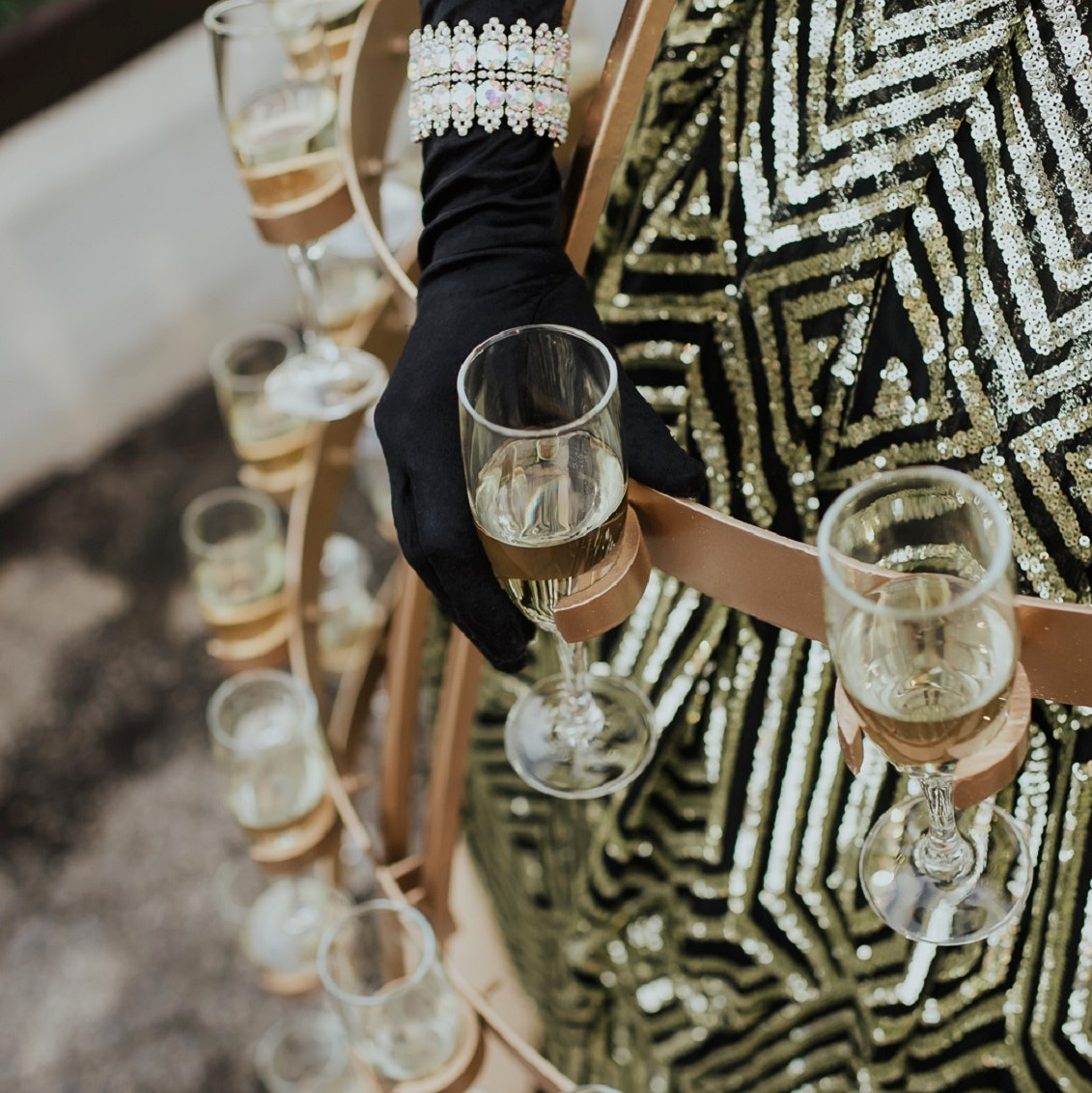 Champagne diva handing guests a glass as they arrive.