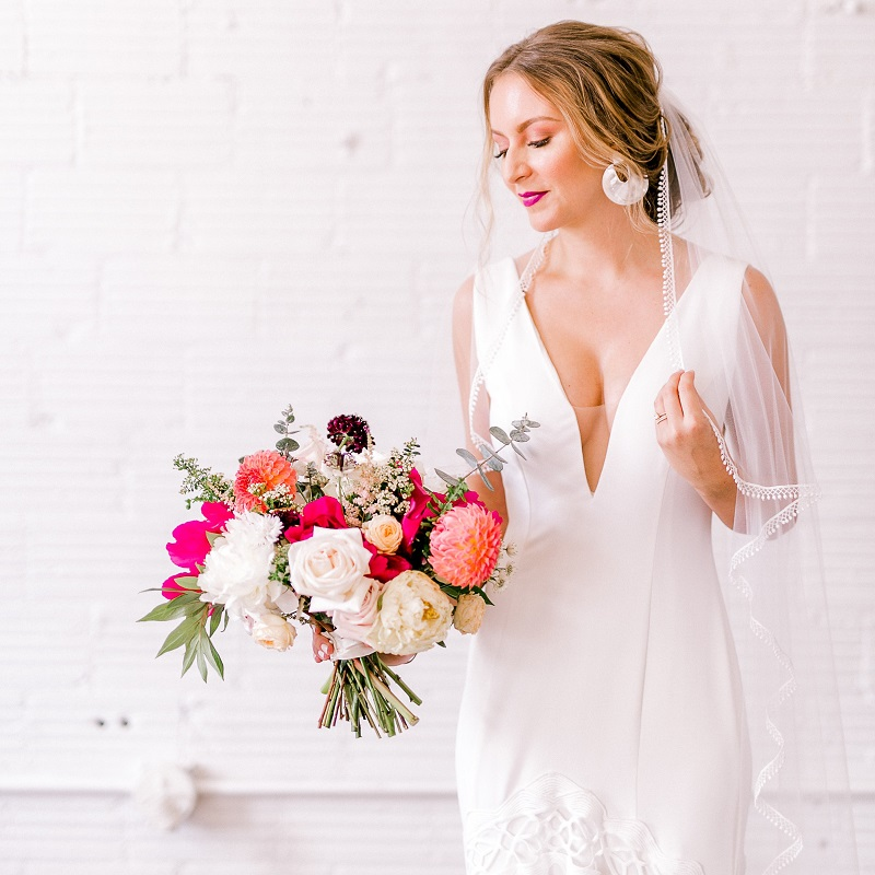 The bride holding her bold bouquet.
