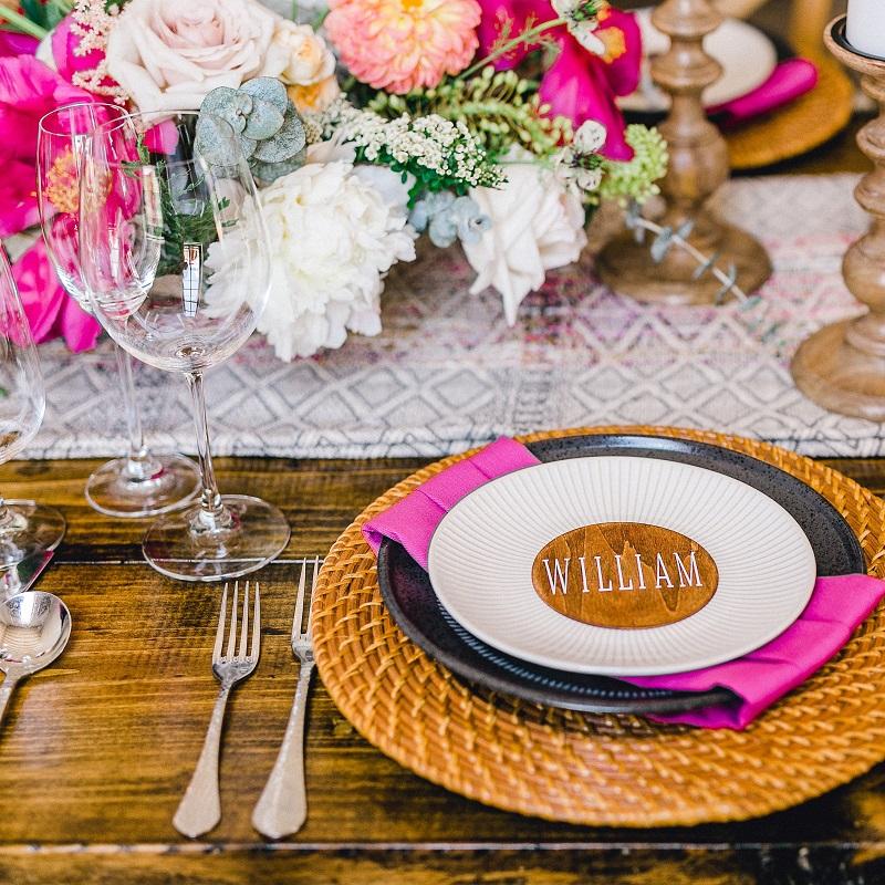 Tablescape of bright floral, unique textures and design.
