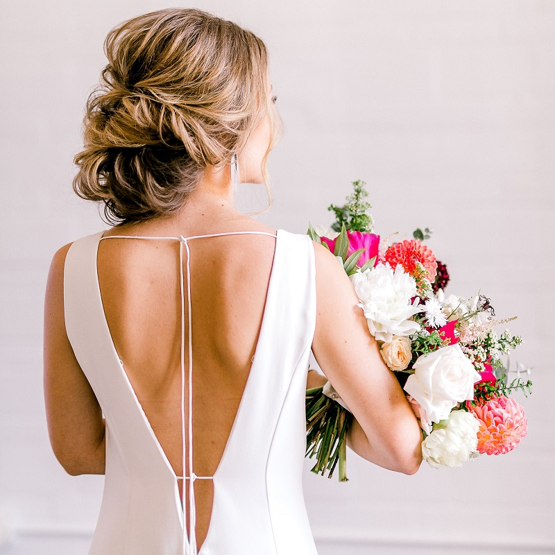Detail of the brides dress and stunning hair design.
