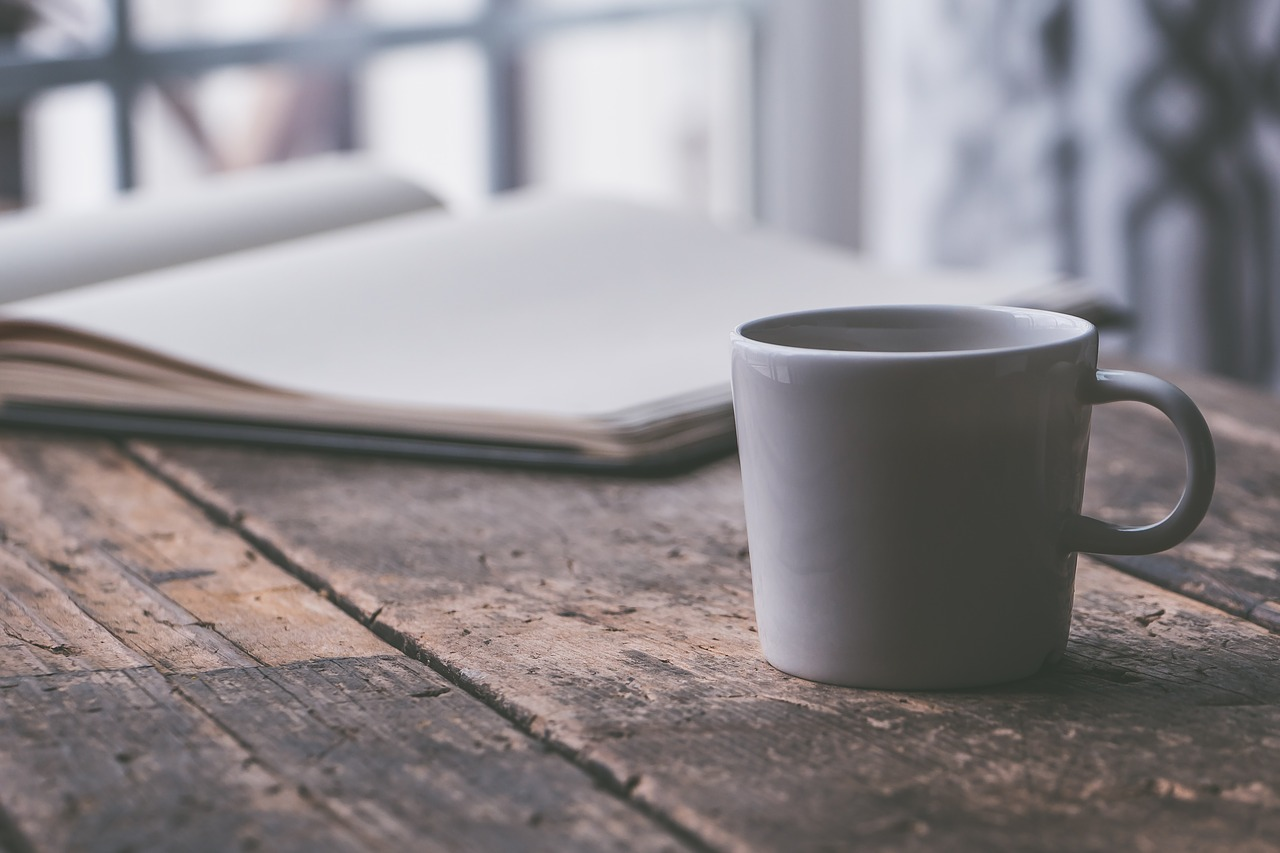 Gray mug with a notebook