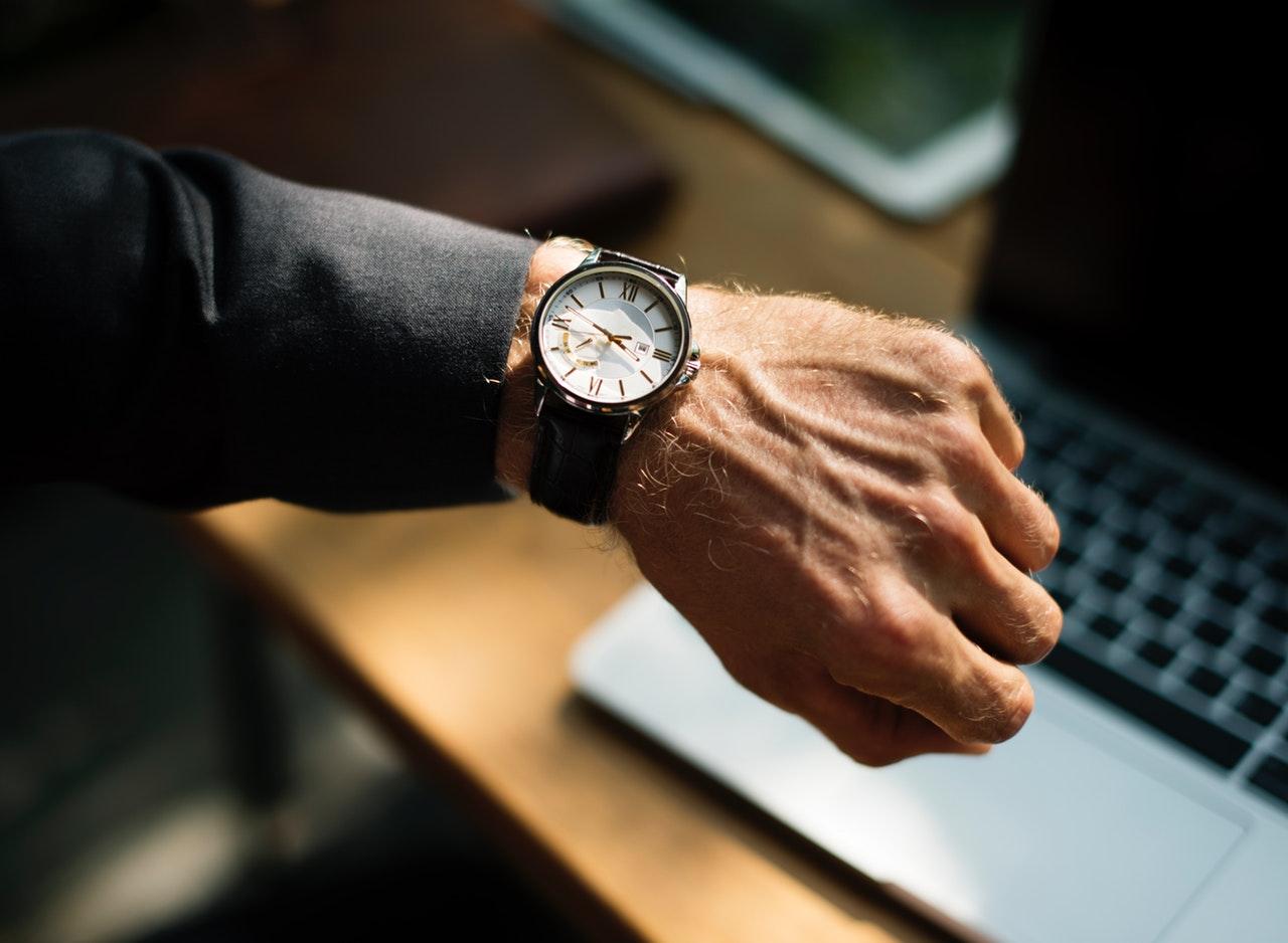 A man's arm with a wristwatch on it