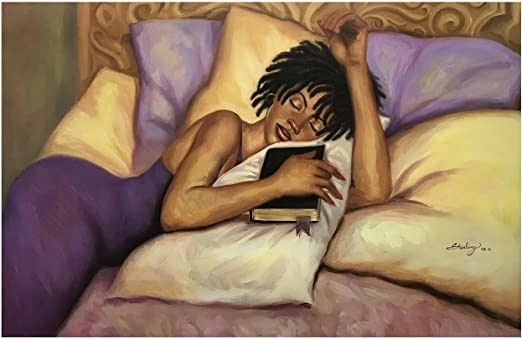 Woman laying in bed holding a book in her hand. Achieve amazing sleep by signaling to your brain that it's time to sleep.
