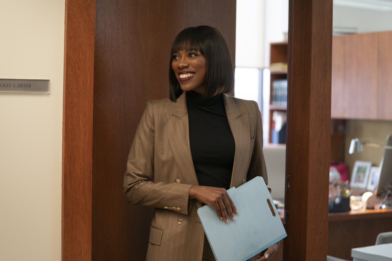 Molly from the HBO show insecure is smiling at the opportunity to move to a new job and create the career that she wants for herself.