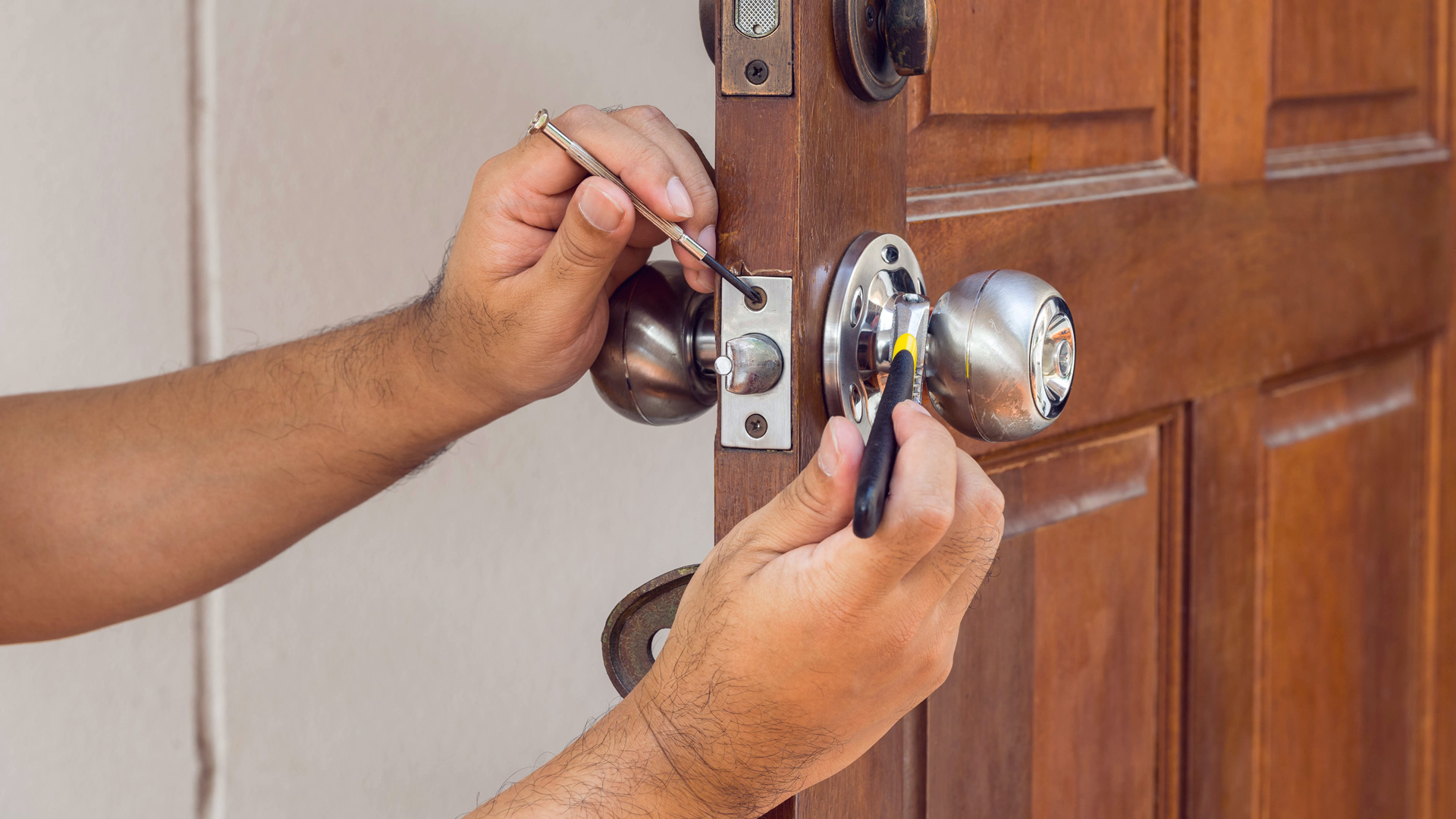 Photo of person fixing a door knob