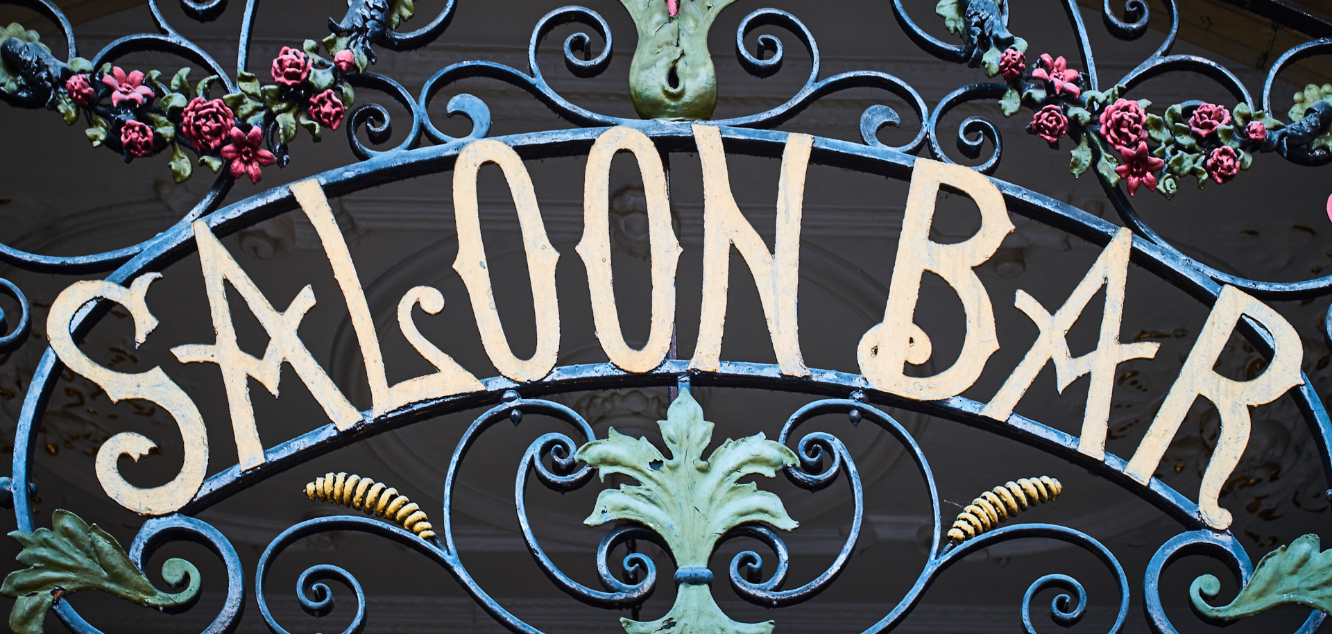 Wrought iron Saloon Bar sign.