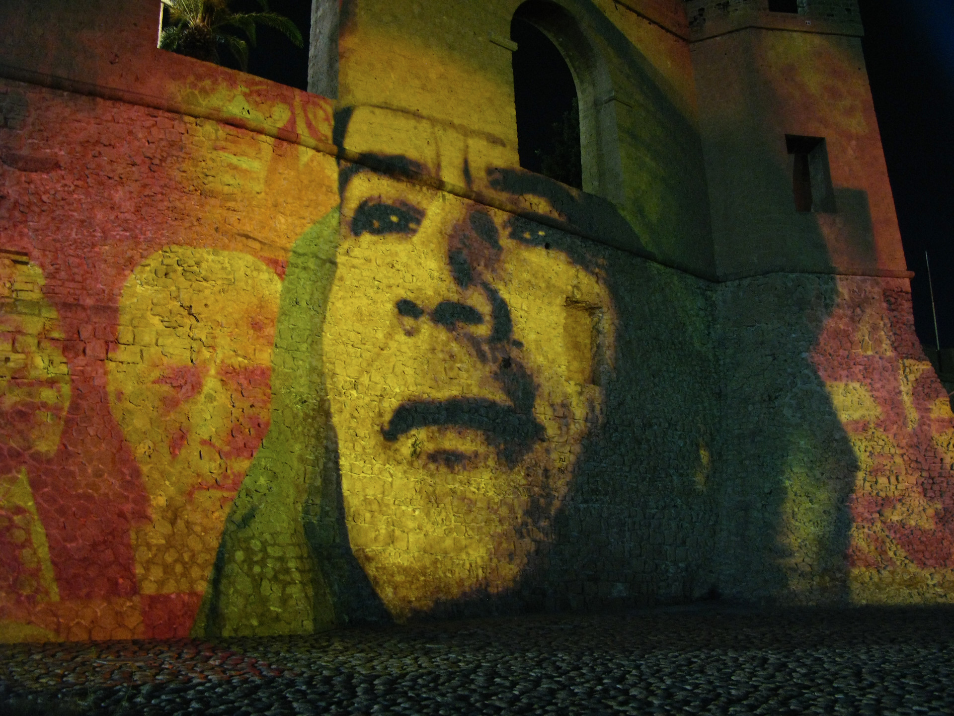 Ghaddafi's image projected onto the walls of Assaria al-Hamra (Red Castle fortress). 2009 Tripoli, Libya.