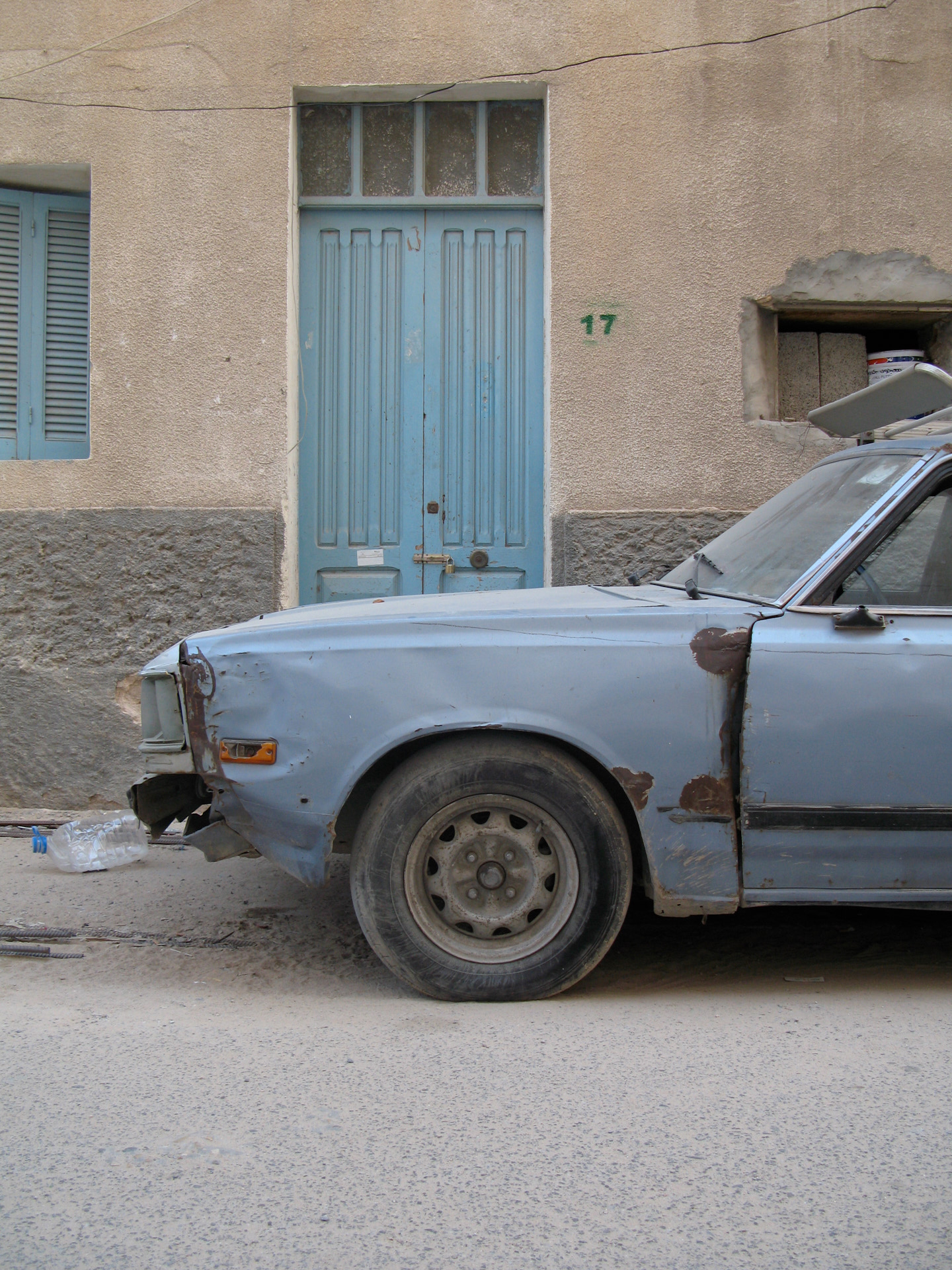 Old car and door. Dhara, Tripoli.