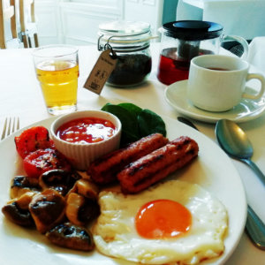 The vegetarian breakfast with egg, sausage, mushroom, beans and tomato
