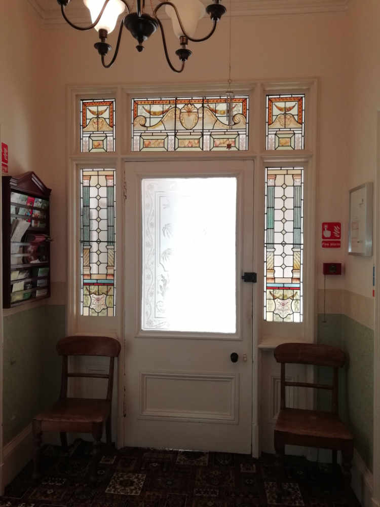 The entrance door with hand painted glass from the 1800s