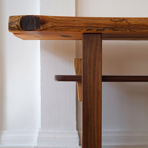 Alan Horsager woodwork. Sitting bench made of a whole trunk 2 inch thick pine board. Legs are made of 2 inch thick, dark heartwood walnut. The support is made with mortise (walnut) and tenon (oak) joinery. All of the work was done by hand using hand saws, hand planers, and chisels.