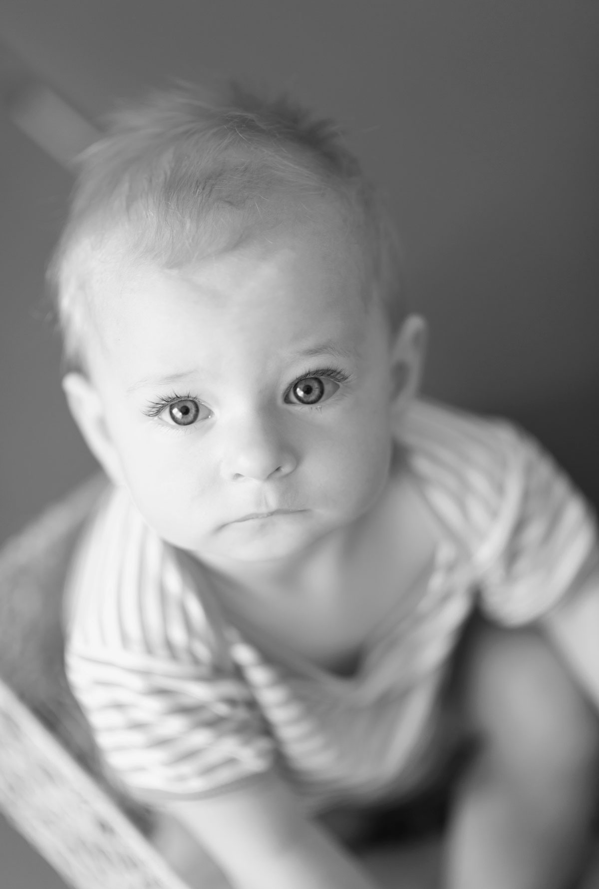 Portrait of a baby girl sitting in the basket in black and white