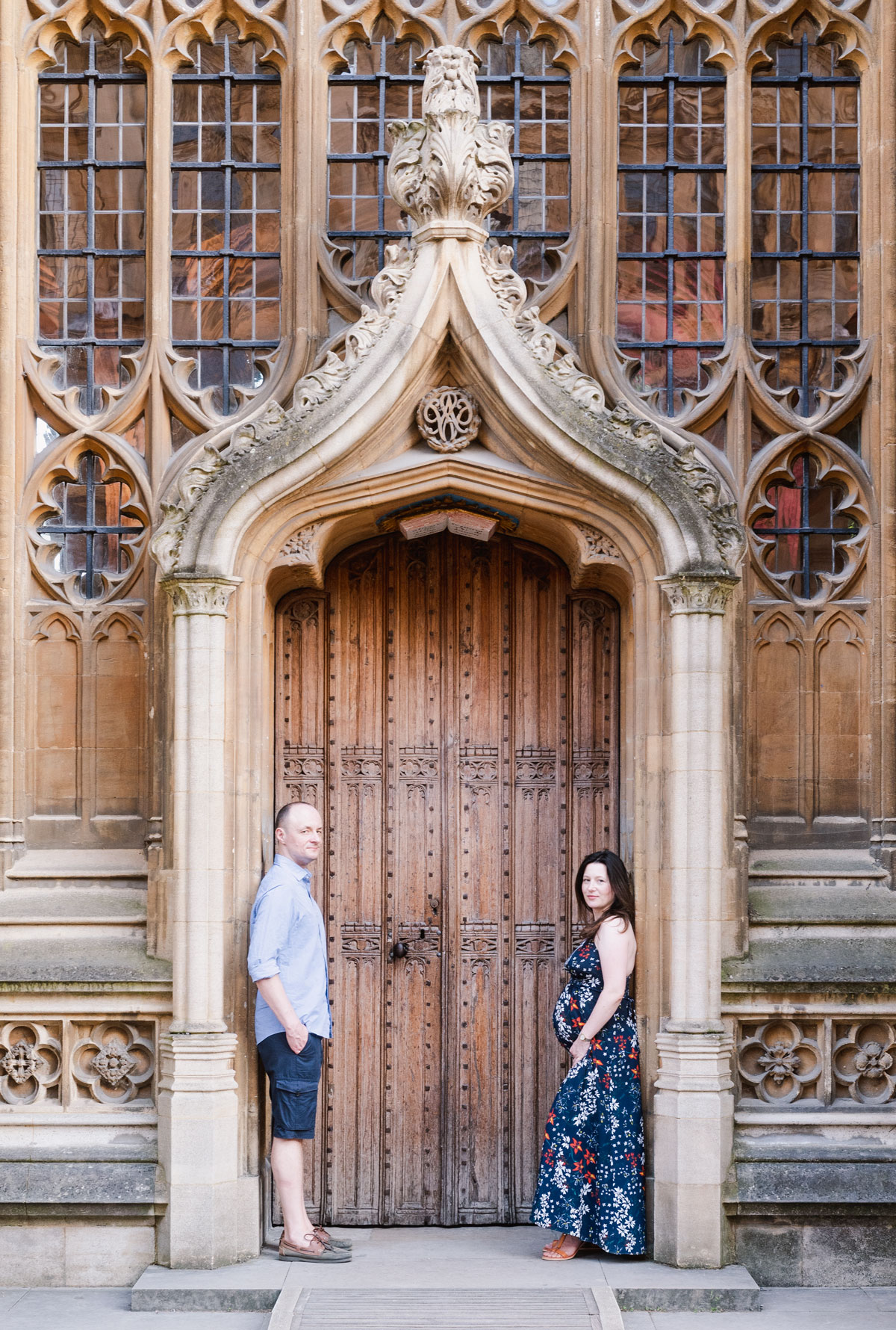 Young couple expecting baby standing in the doorway in Oxford