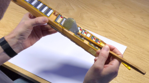 Accordion Tuning and Repairs - Waxing accordion reeds into a reed block