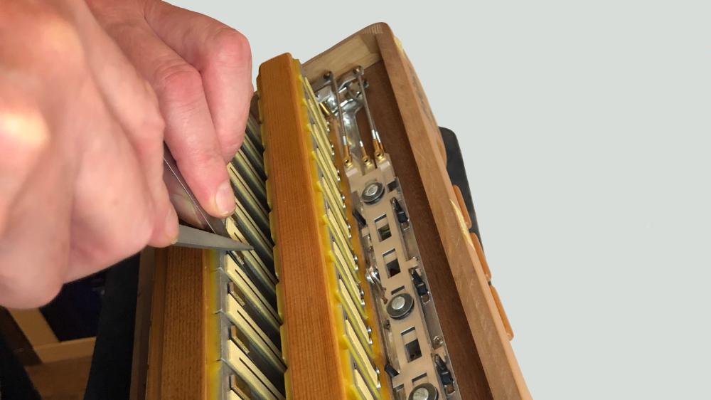 Accordion Tuning and Repairs - Accordion reed blocks before refurbishment.