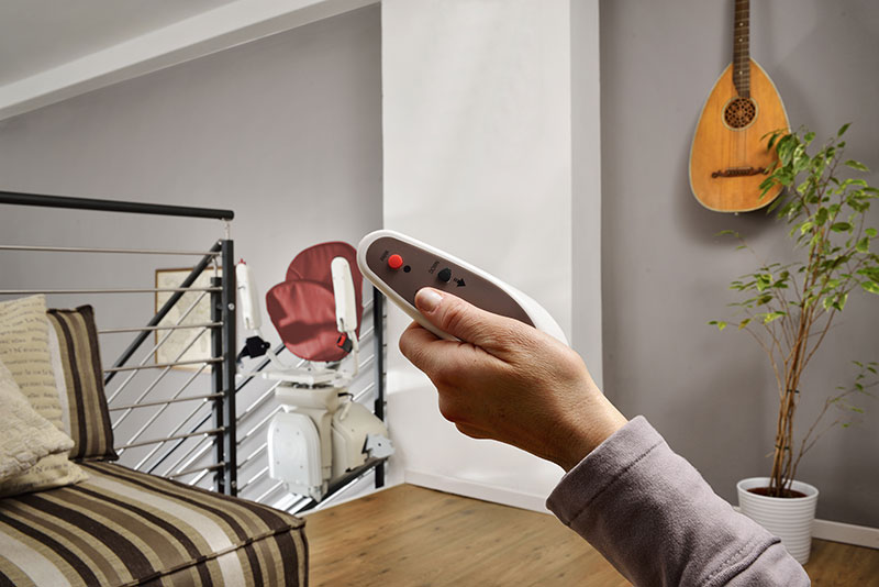 Person holding the stairlift wireless remote