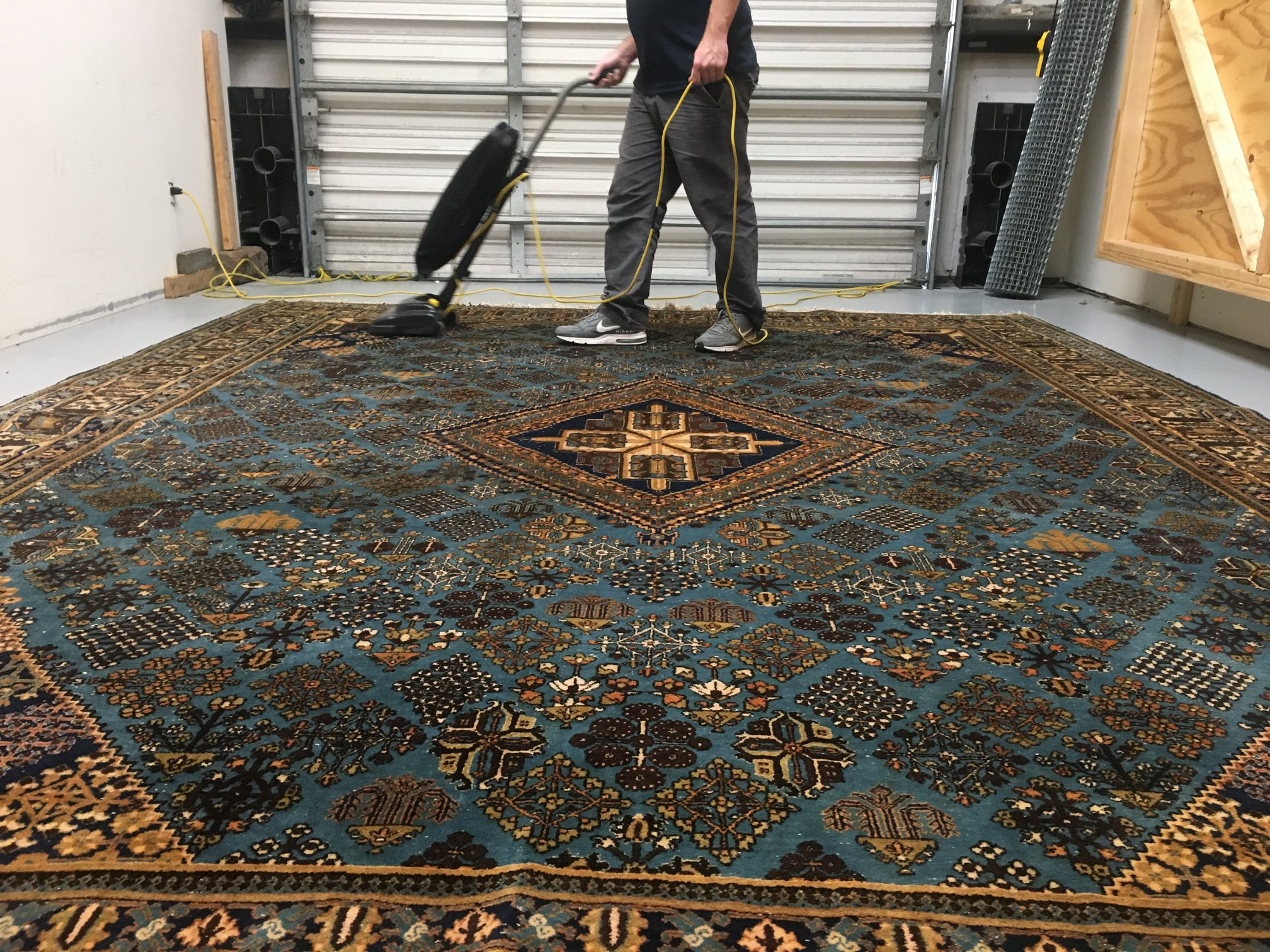 clear water technician commercially vacuuming area rug