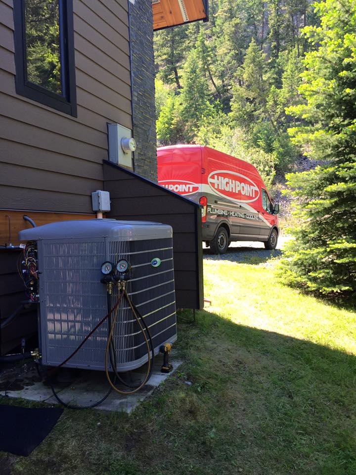 high point plumbing heating cooling van near a cranbrook home