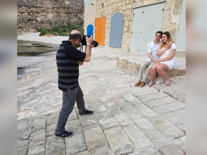 Photographer behind the scenes shooting couple in Dwejra Gozo
