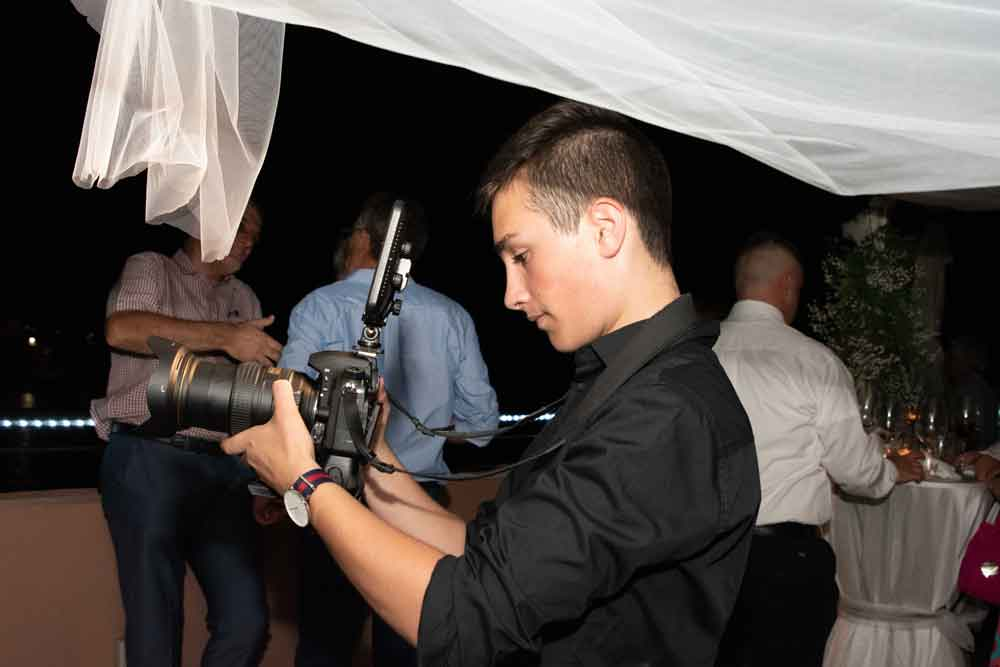 Darren Cassar shooting a video for a couple during a wedding - (Post tile:) Why you should only get a Wedding Photographer (and not a videographer) - Anaca Photography