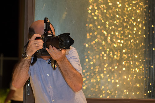 Anthony Cassar shooting a couple during a wedding in Ta Frenc Restaurant in Gozo, Malta.