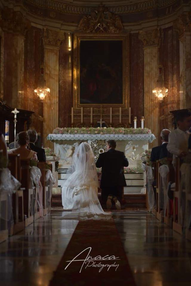 A couple waiting to get married in a church. - Nadur Basilica - Photo by Anaca Photographer: Wedding Photographers in Gozo.