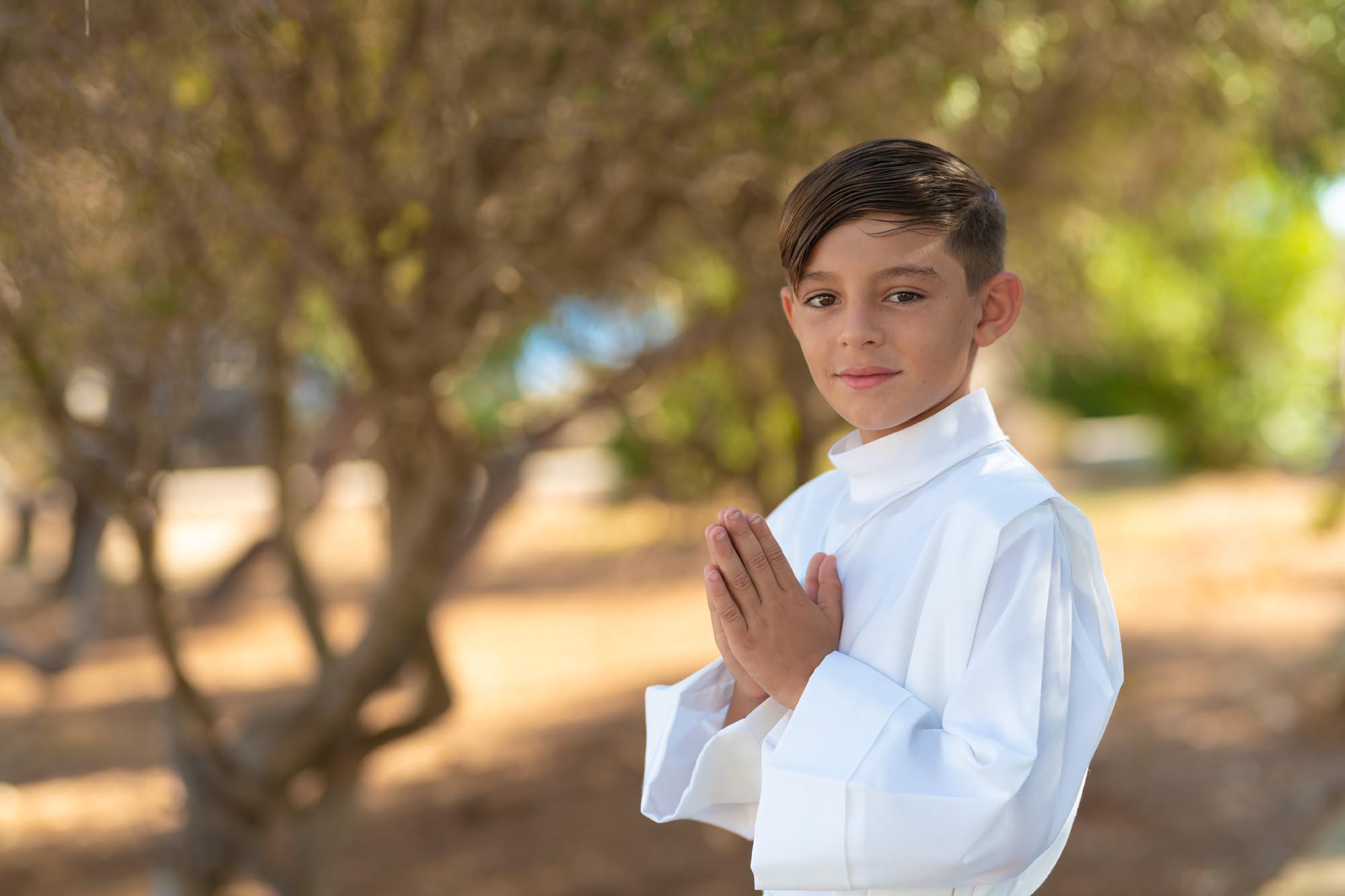 boy posing for communion photo in Nadur