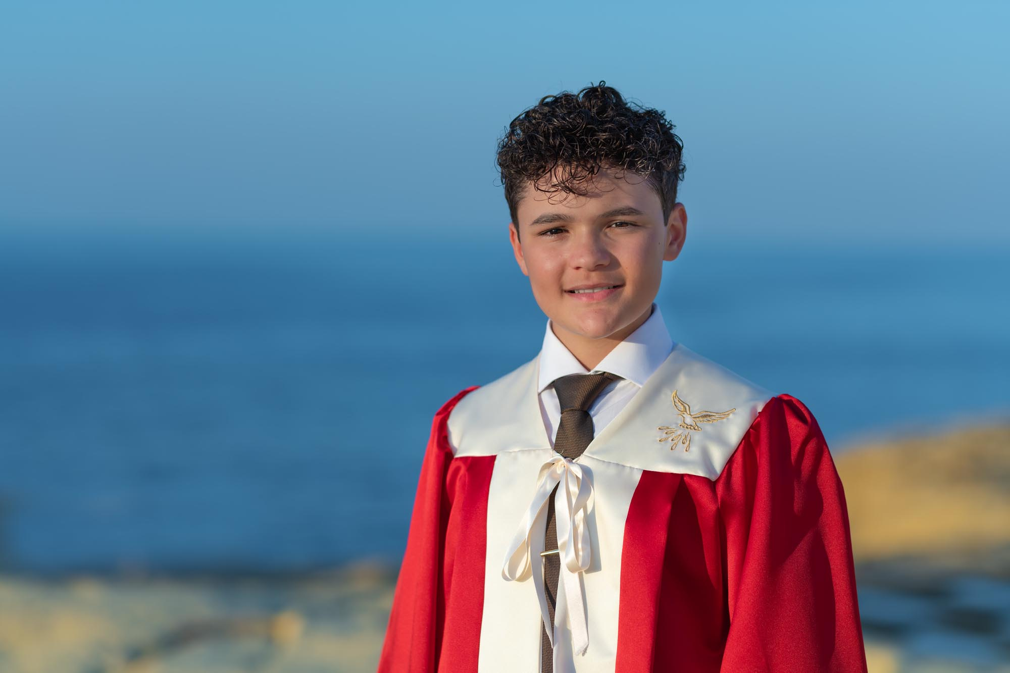 Boy smiling wearing confirmation jacket in Gozo. Photographed by Anaca