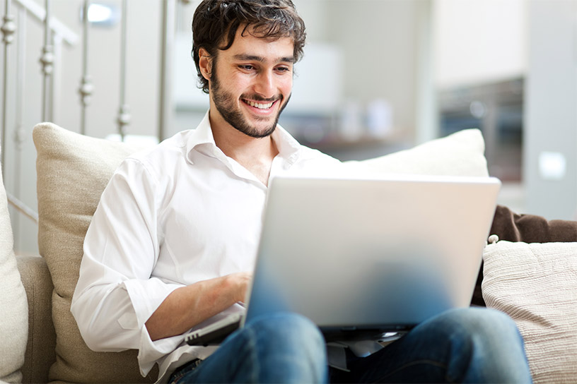 man looks at conveyancing on his laptop