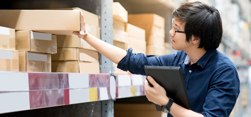 man checking stock for preparation of business sale document