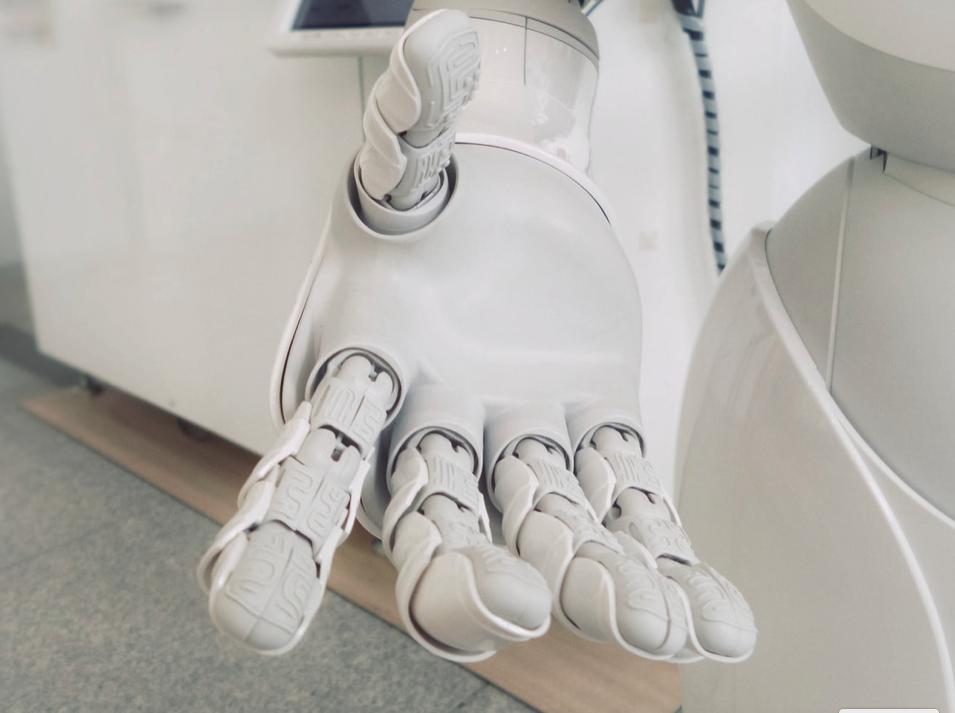 white robot extending hand